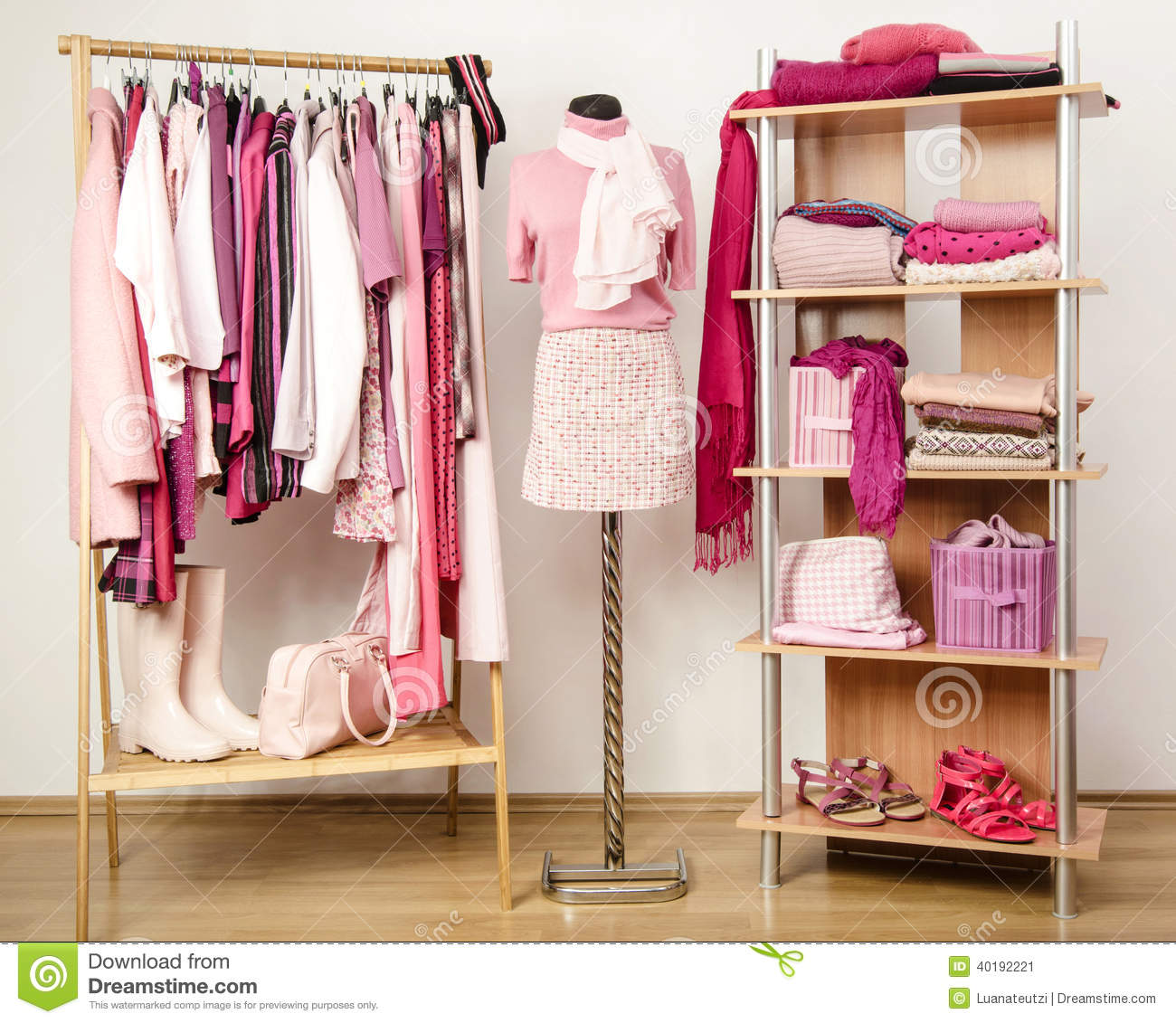 Royalty Free Stock Photo. Download Dressing Closet With Pink Clothes  Arranged On Hangers And ...