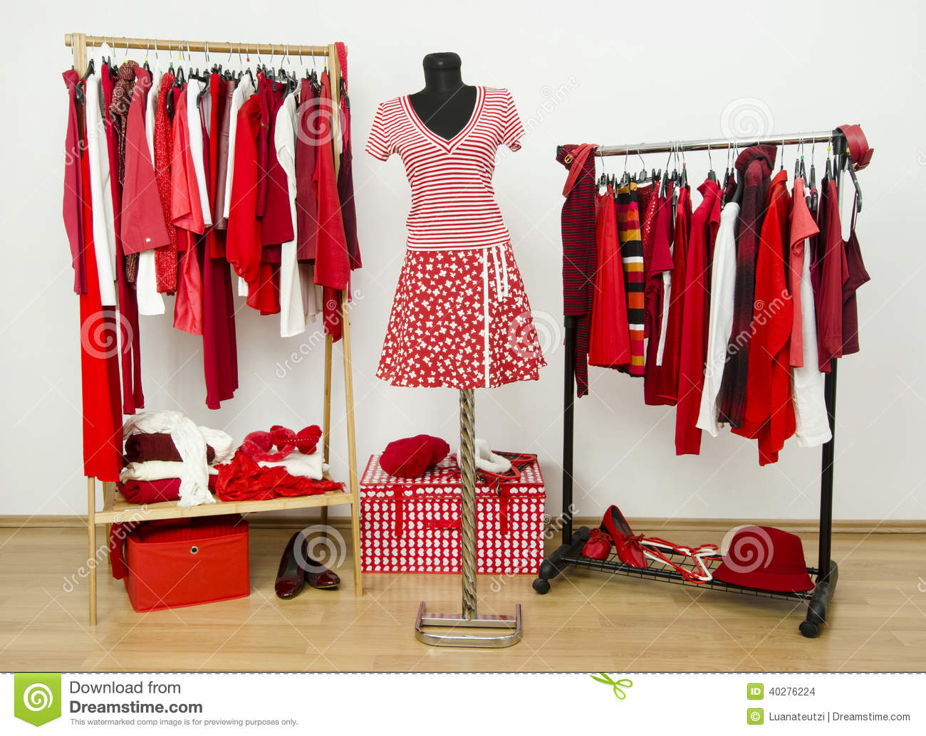 Dressing Closet With Red And White Clothes Arranged On Hangers And An Outfit On A Mannequin