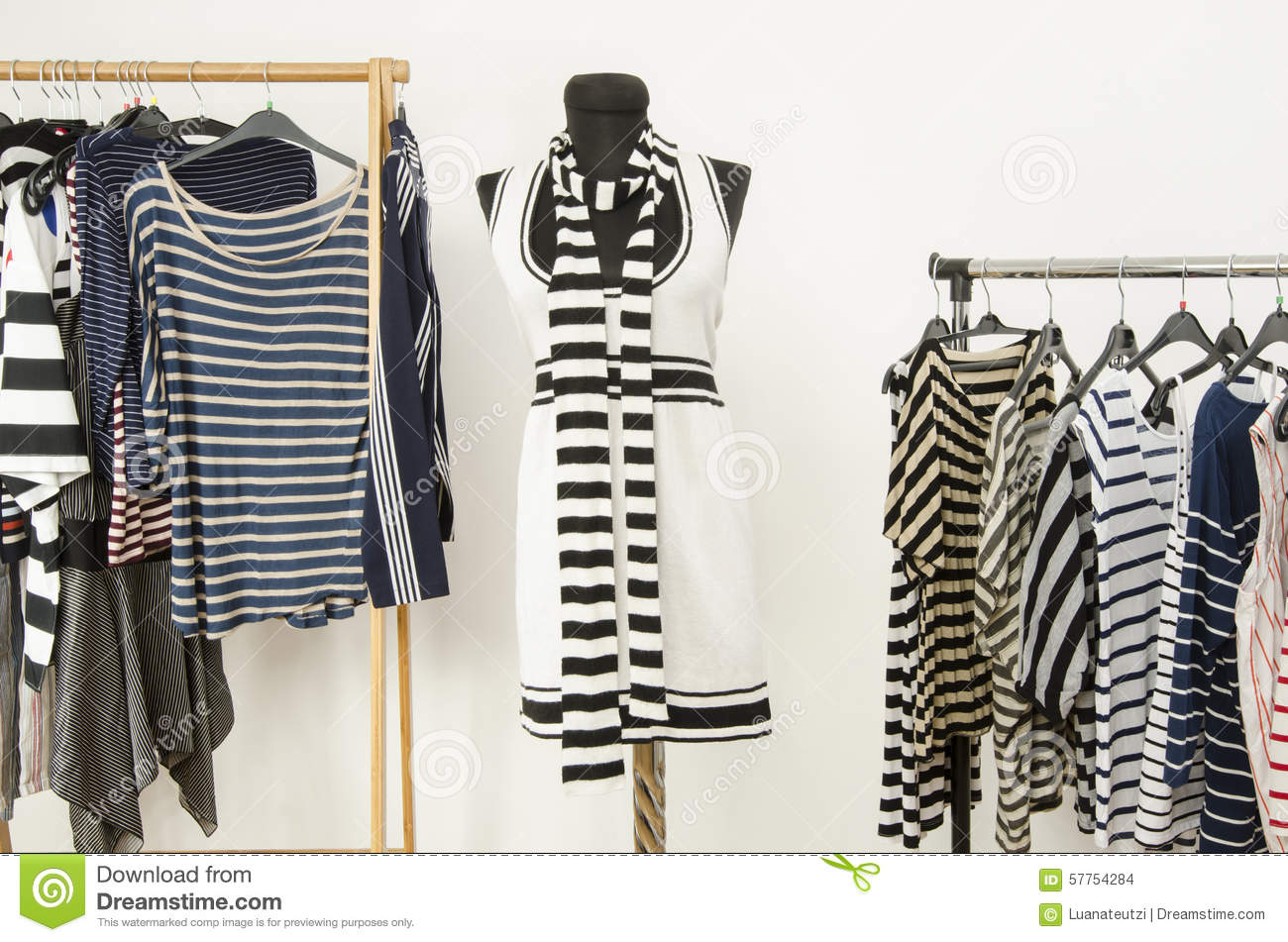 Dressing Closet With Striped Clothes Arranged On Hangers