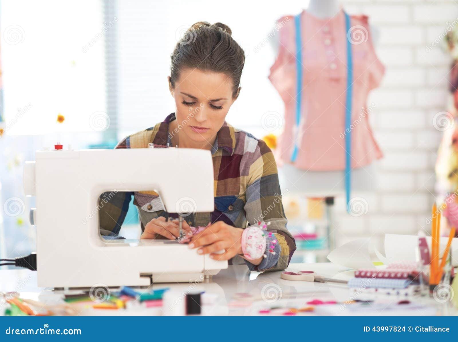Modern dressmaker buttons - Dressmaker Woman Working With Sewing Machine