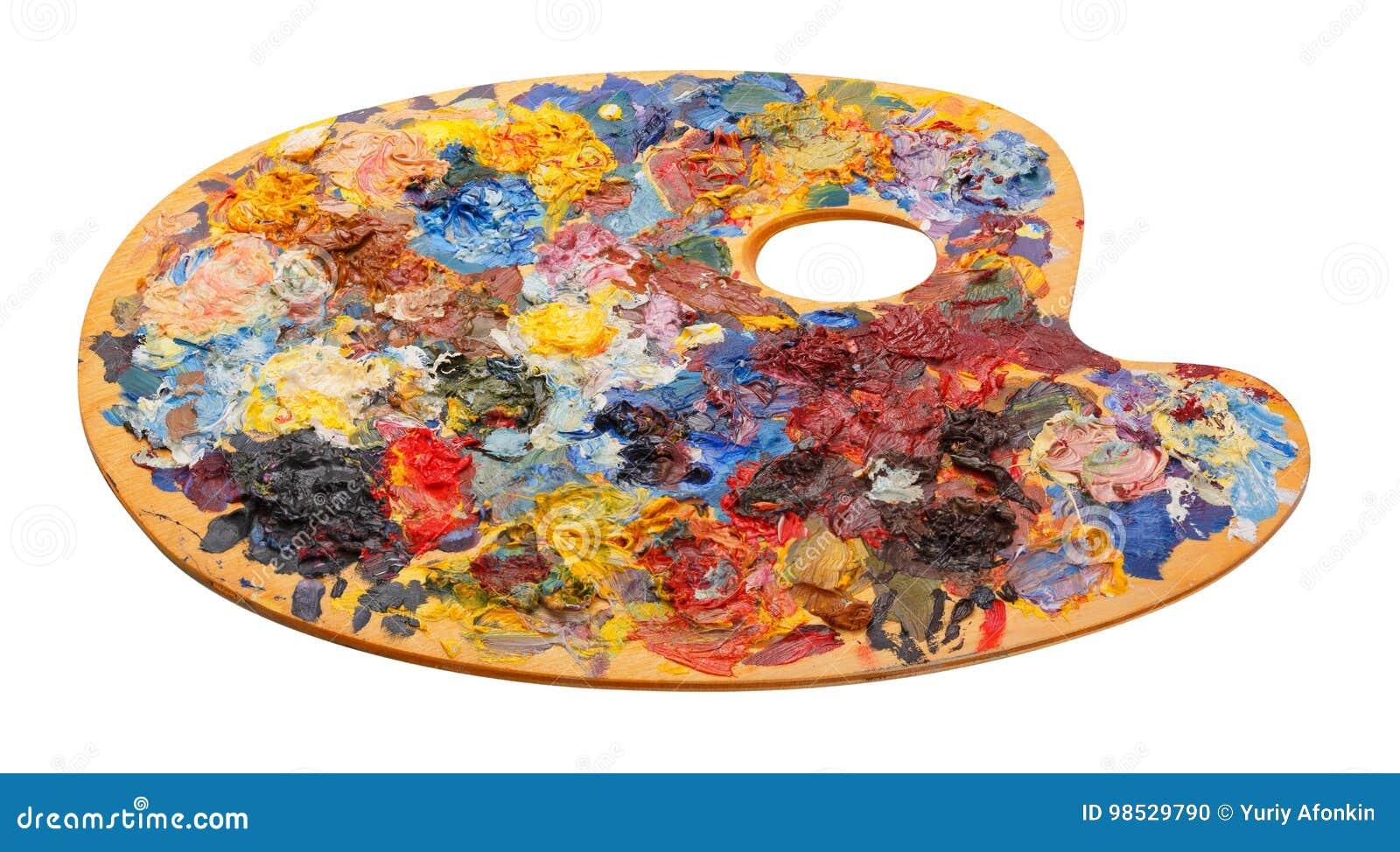 Drewniana sztuki paleta z nafcianymi farbami i muśnięcia odizolowywający na whi