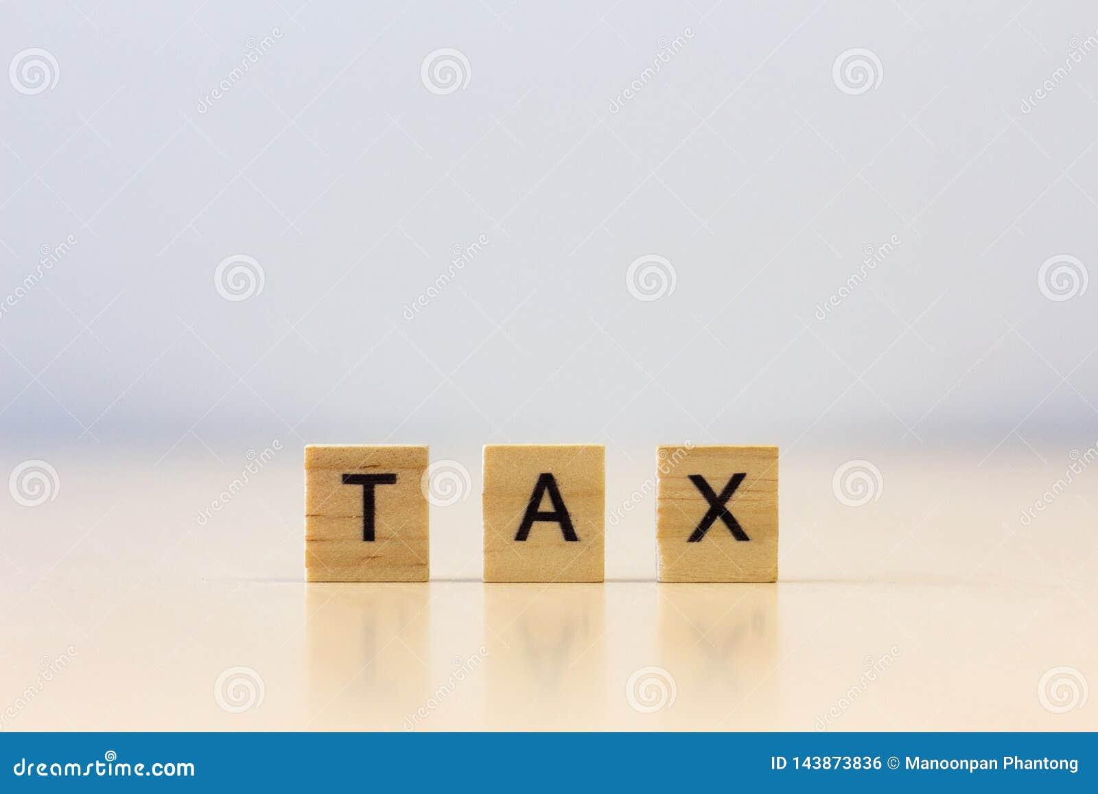 Drewnianego sześcianu słowa «podatki na stole