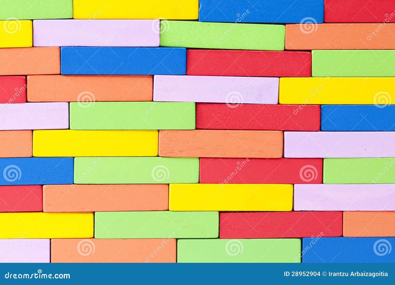 Drewniani kolorowi bloki, wyrównujący. Textured tło