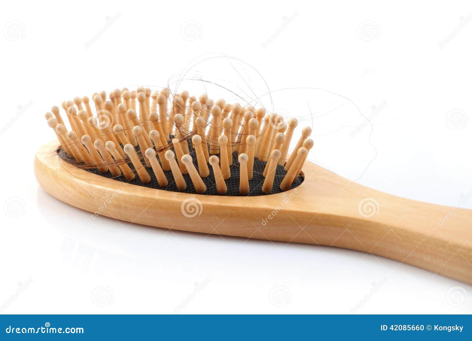 Drewniany grępli muśnięcie z przegranym włosy