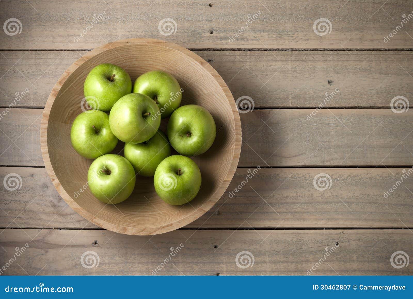 Drewniany pucharów jabłek tło