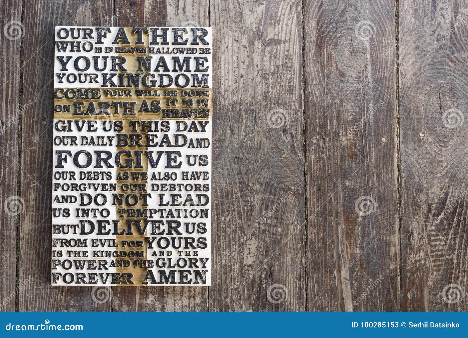 Drewniany rzeźbiący słowo władyki ` s modlitwa na ciemnym podławym drewnianym deski tle