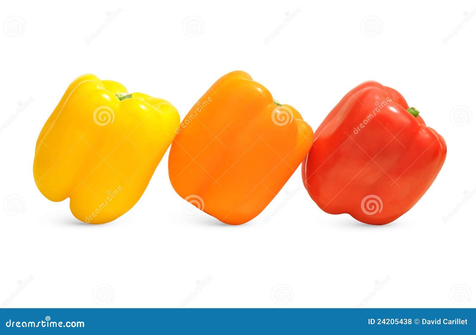 Drie groene paprika's in geel, oranje, en rood royalty vrije stock ...