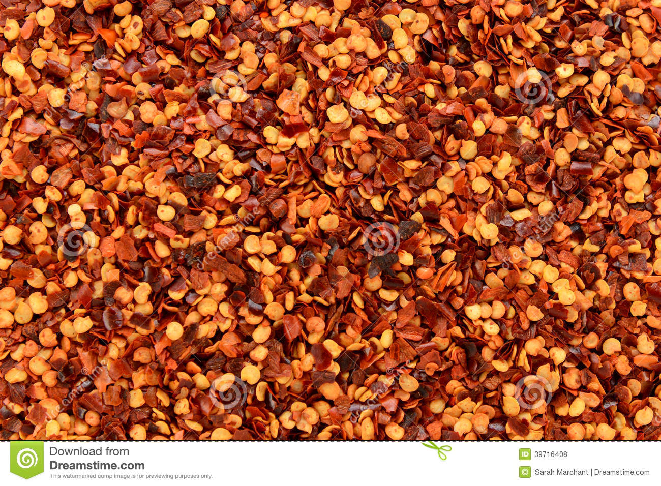 Dried chilli flakes and seeds abstract background texture for Chili flakes