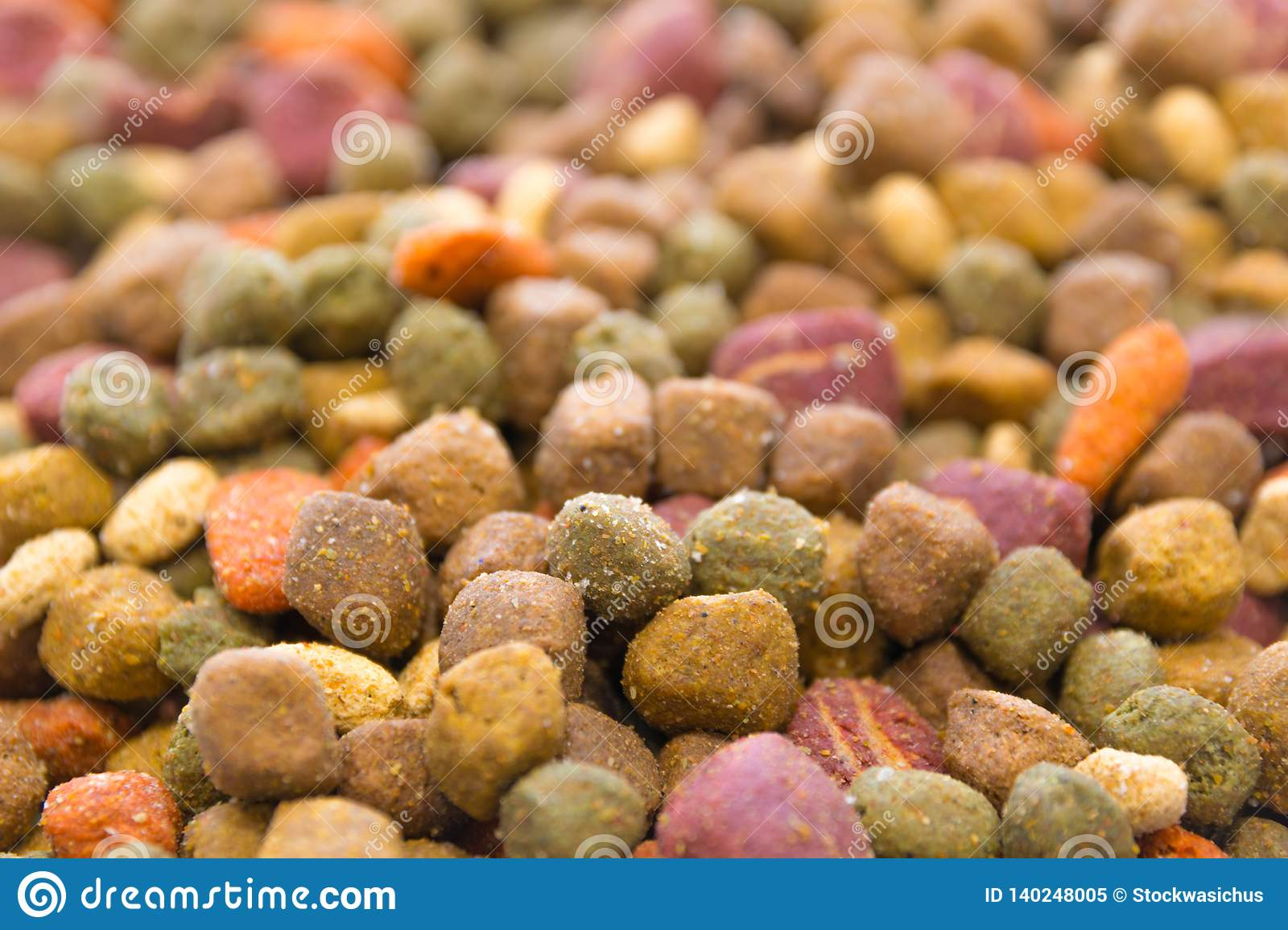 Dried dog food background. Colorful dog treats close up