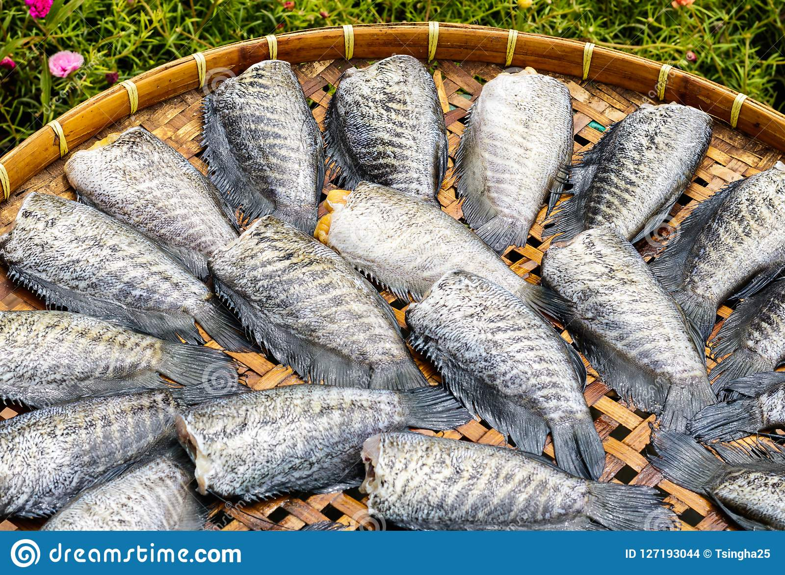 Dried fish on bamboo basket.