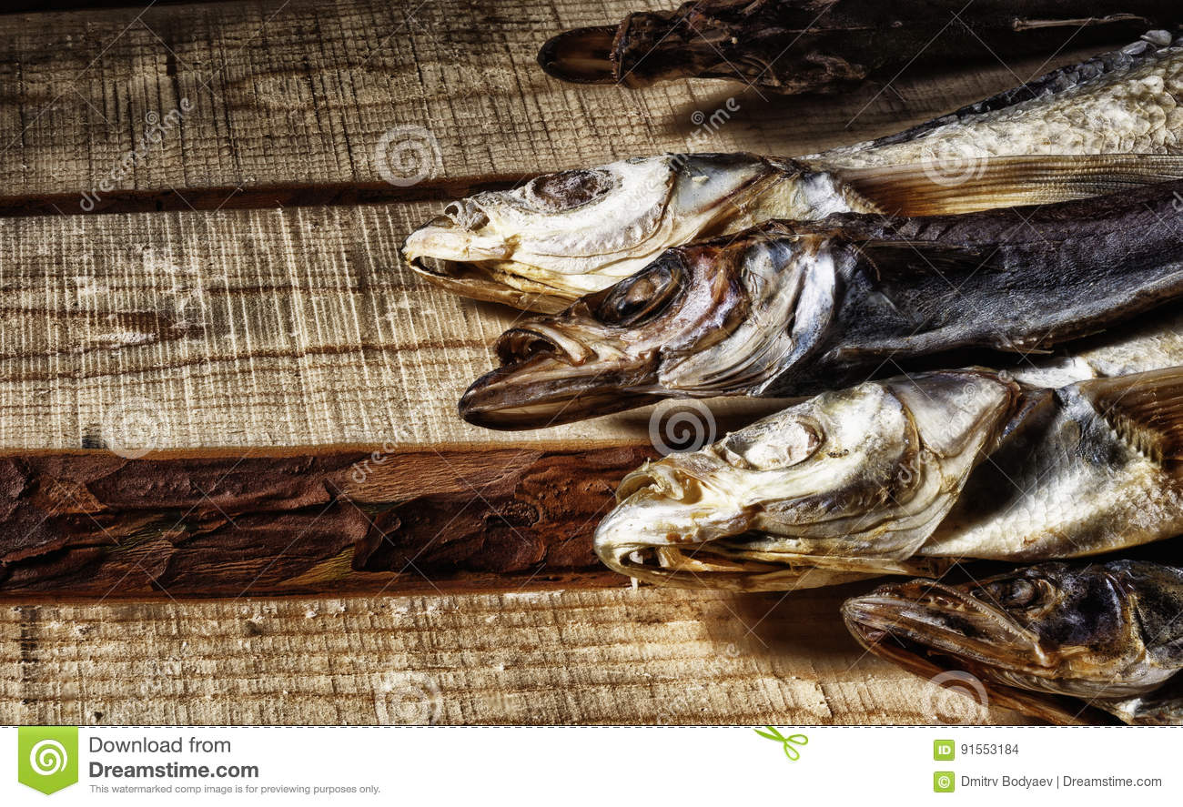 The dried fish lies on the boards