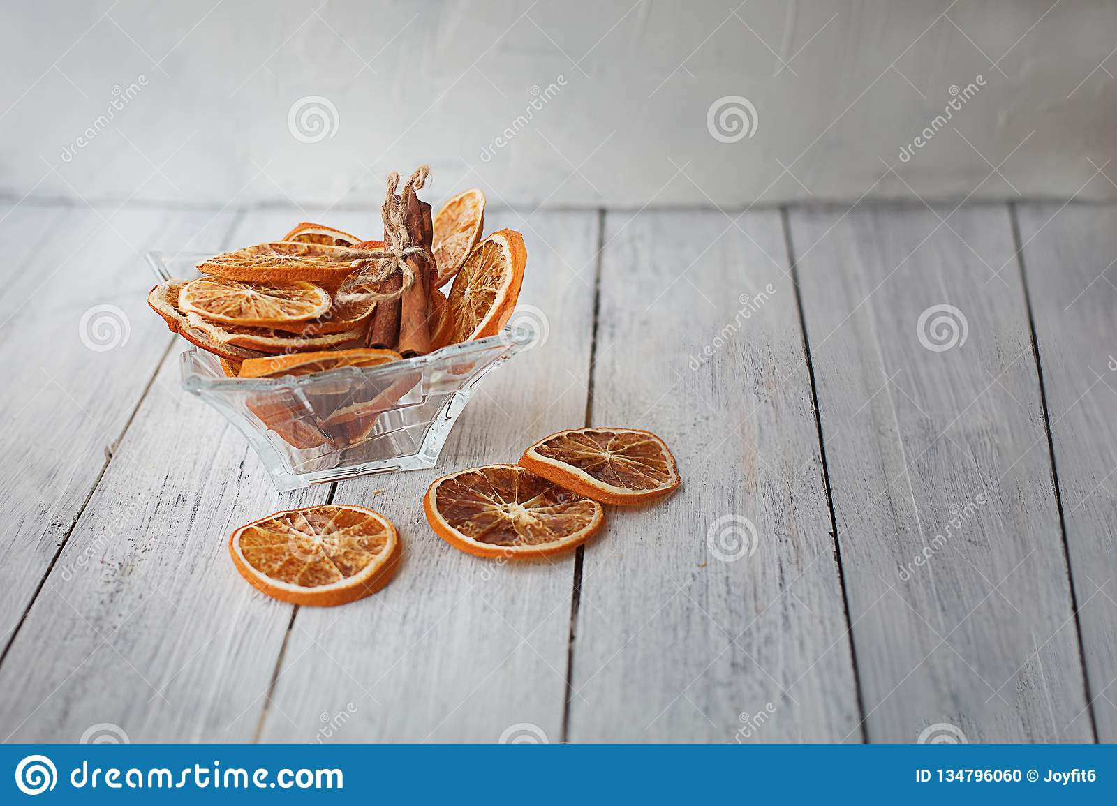 Dried orange slices with cinnamon in a vase