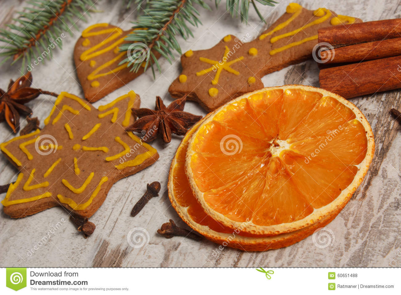 dried orange spices and decorated gingerbread on old