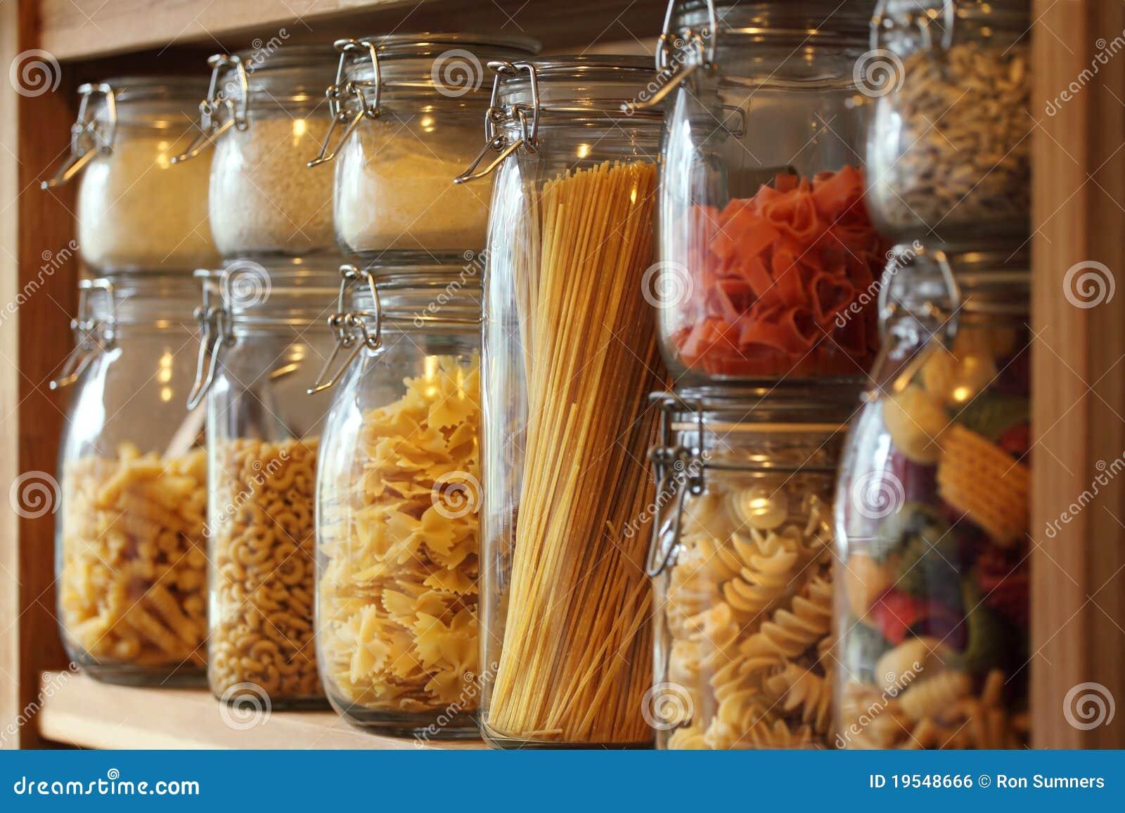 Dried pasta in jars on a shelf