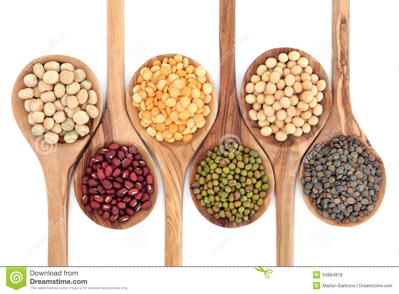 Pulses food selection in olive wood spoons over white background.