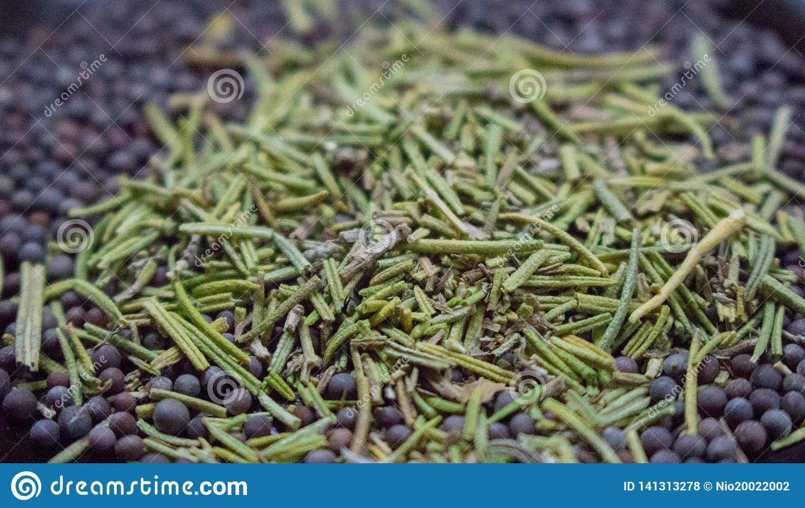 Dried rosemary with black mustard seeds closeup. Spices background. Aroma herbs and spices.