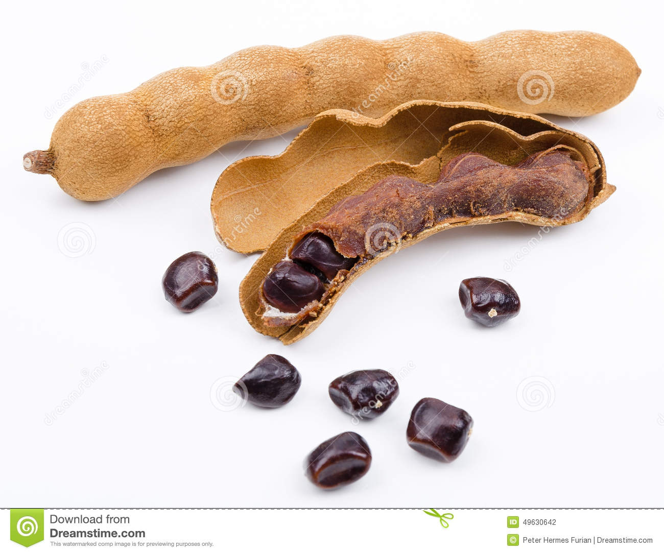 Dried tamarind fruits with seeds on white background. One open pod ...