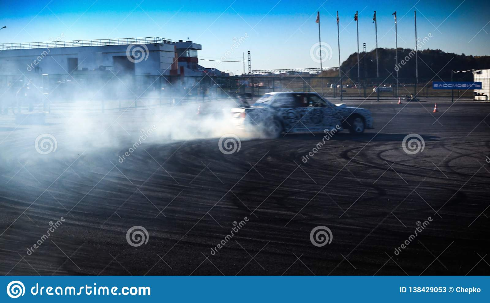 A drift racing car in action with smoking tires in show