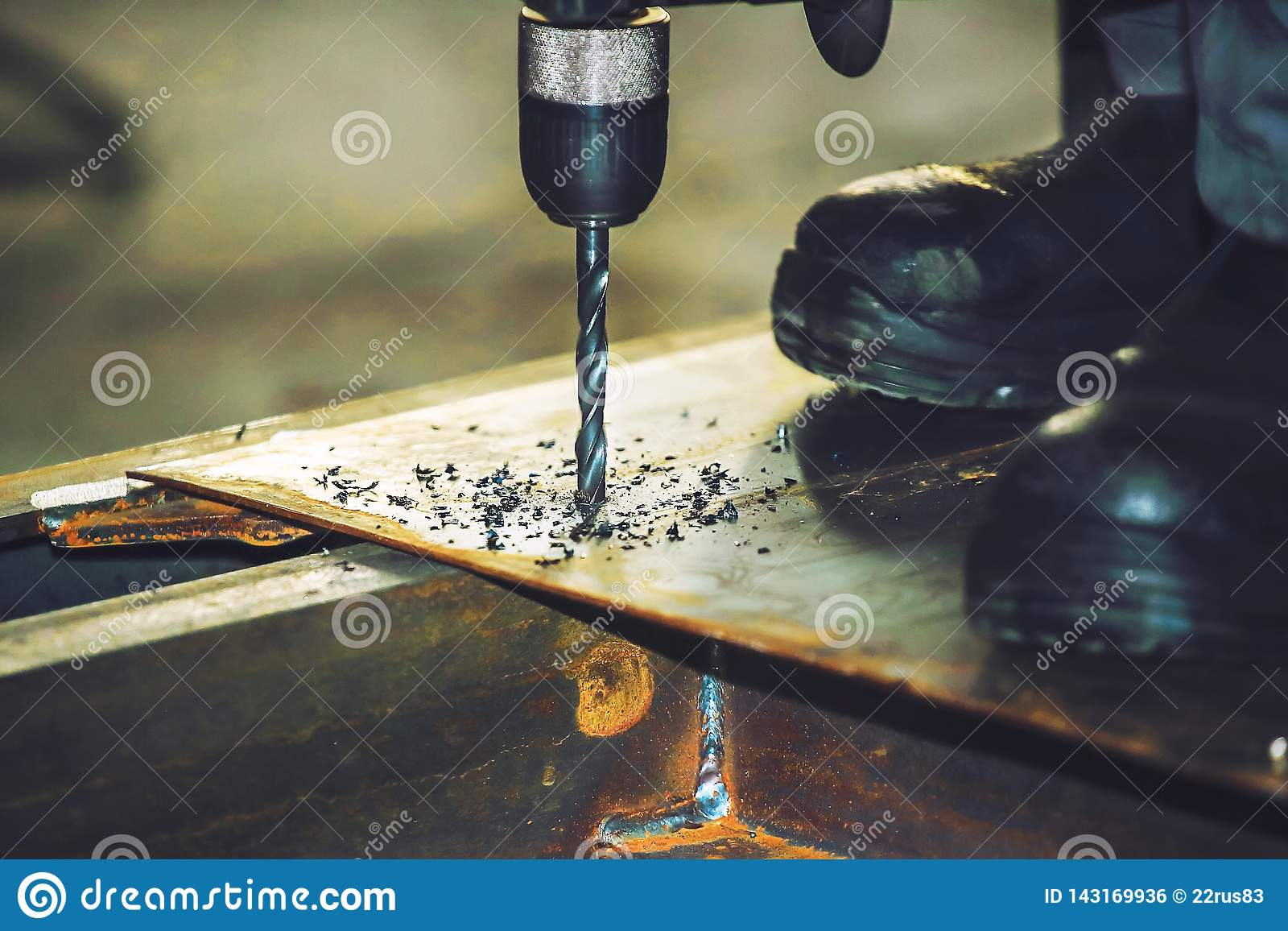 Drilling metal sheet tool. Production background for construction companies