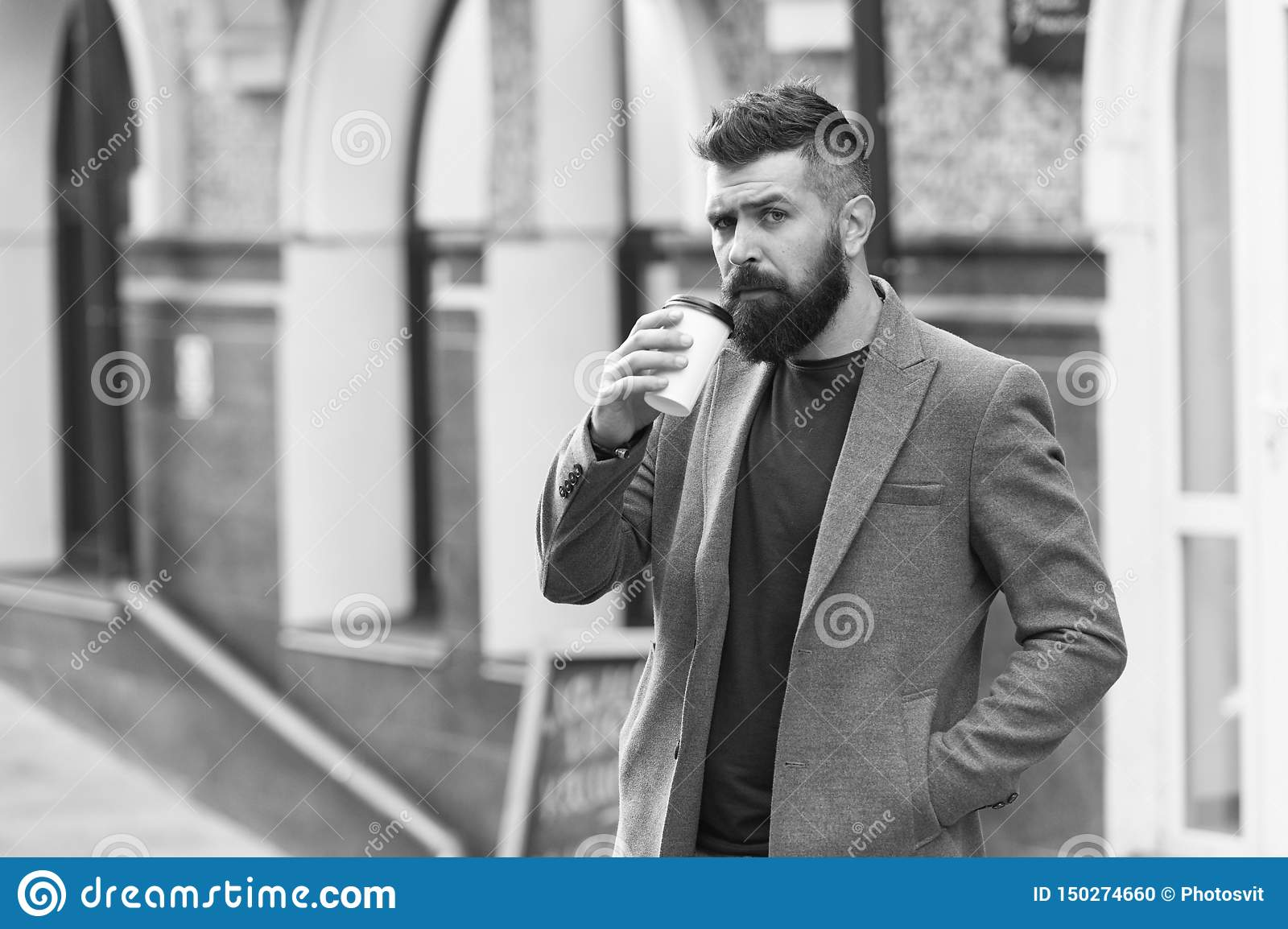 Drinking coffee on the go. Businessman lumbersexual appearance enjoy coffee break out of business center. Relax and