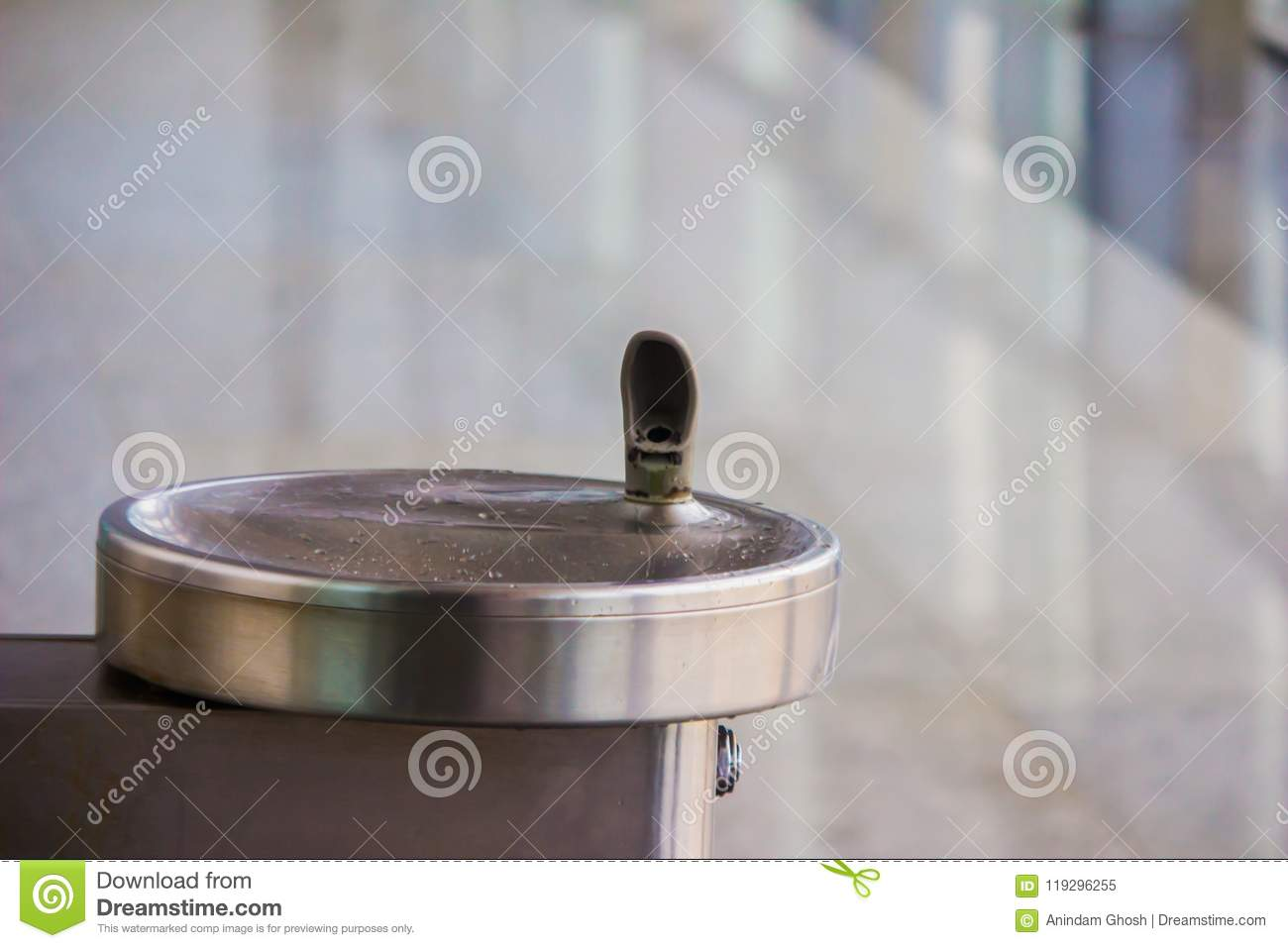 Drinking water fountain outlet in airport with water cooler and steep tap and steel sink basin