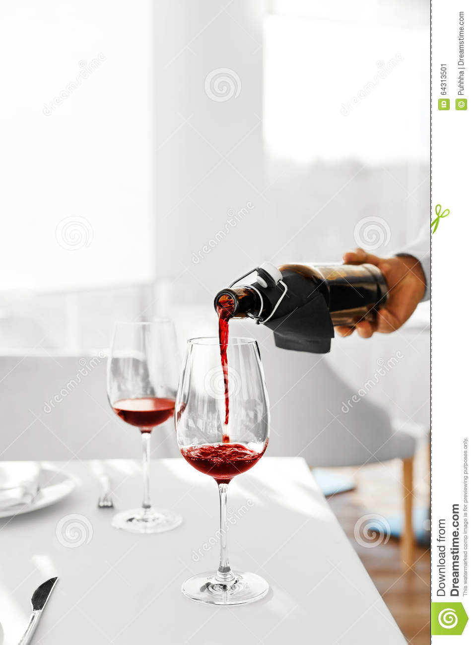 Drinks. Closeup Of Pouring Red Wine From Bottle Into Glass ...