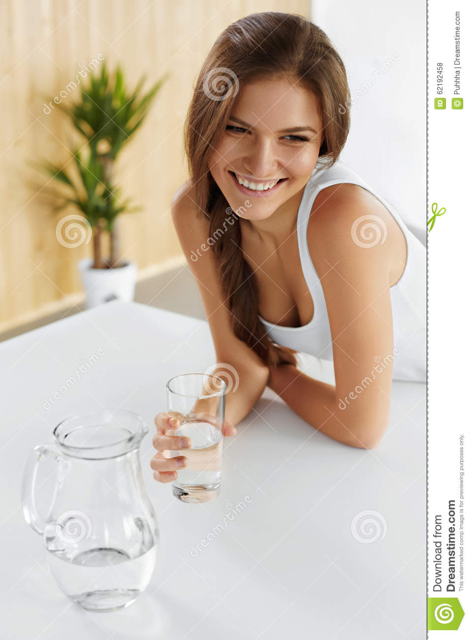 Drinks. Happy Girl Drinking Water. Healthcare. Healthy Lifestyle