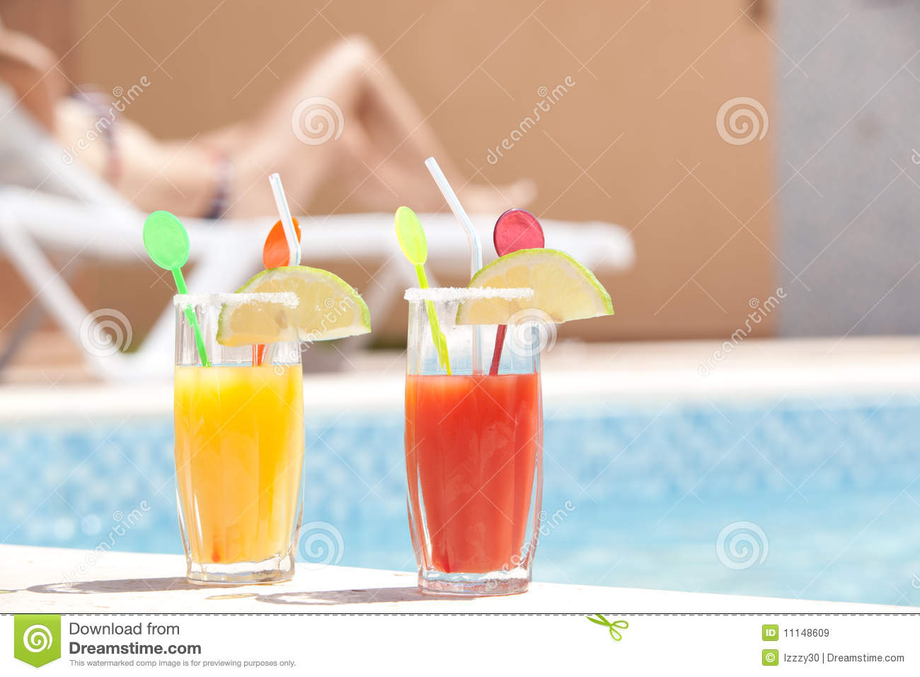 Drinks Near The Pool With Young Woman Sunbathing I Royalty Free Stock Image