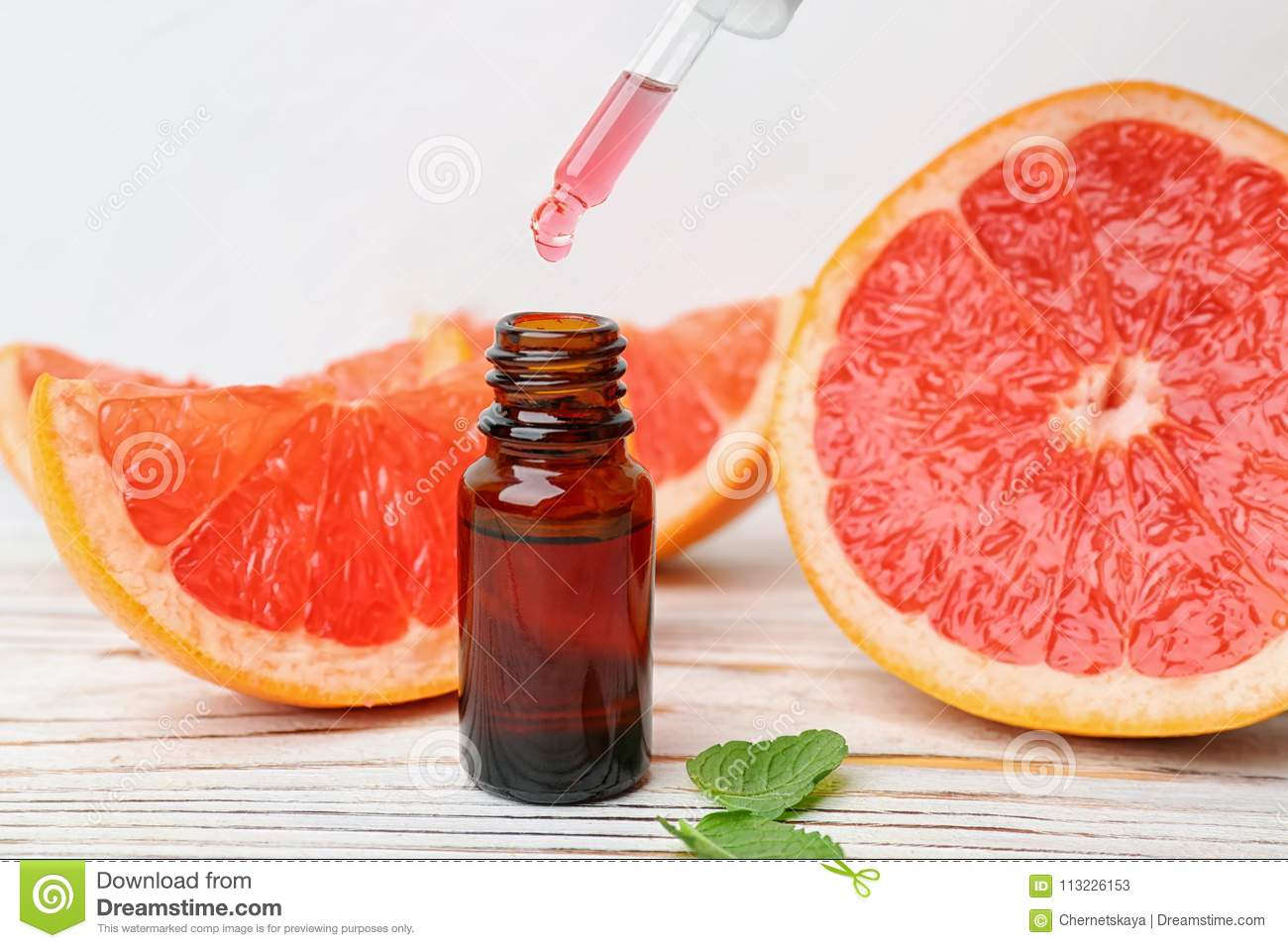 Dripping citrus essential oil into bottle