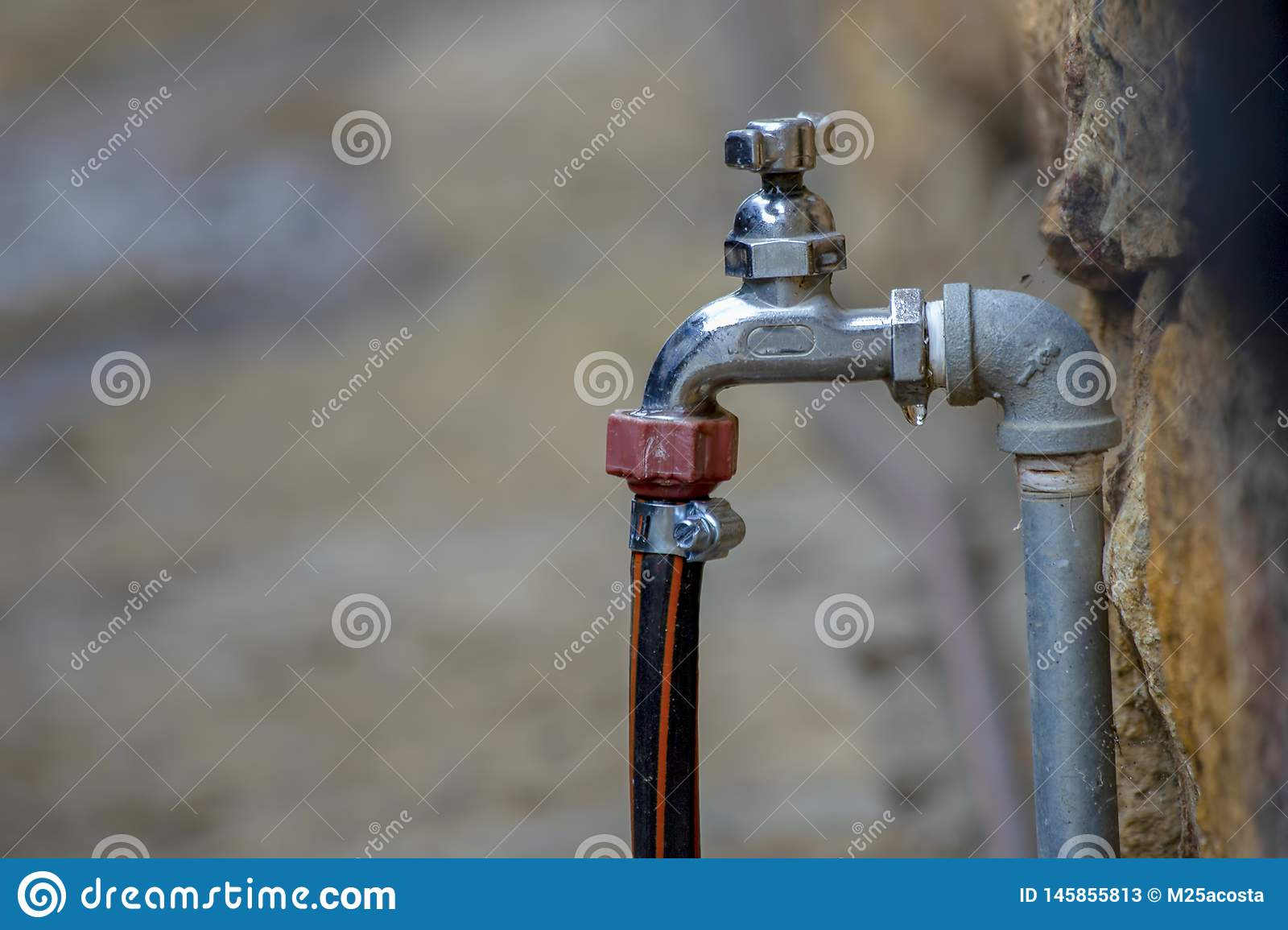 Dripping faucet with the hose connected