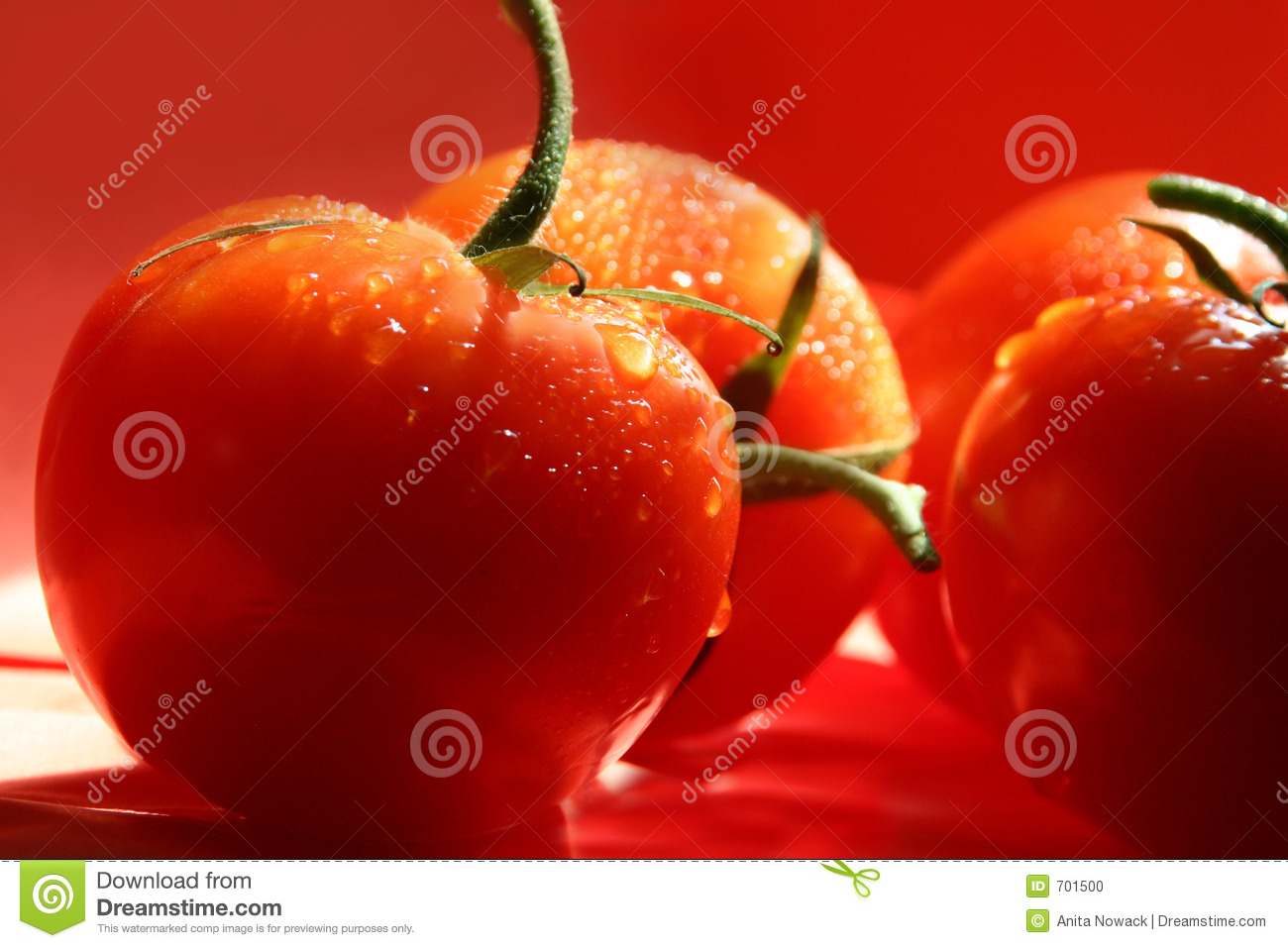 Dripping red tomatoes