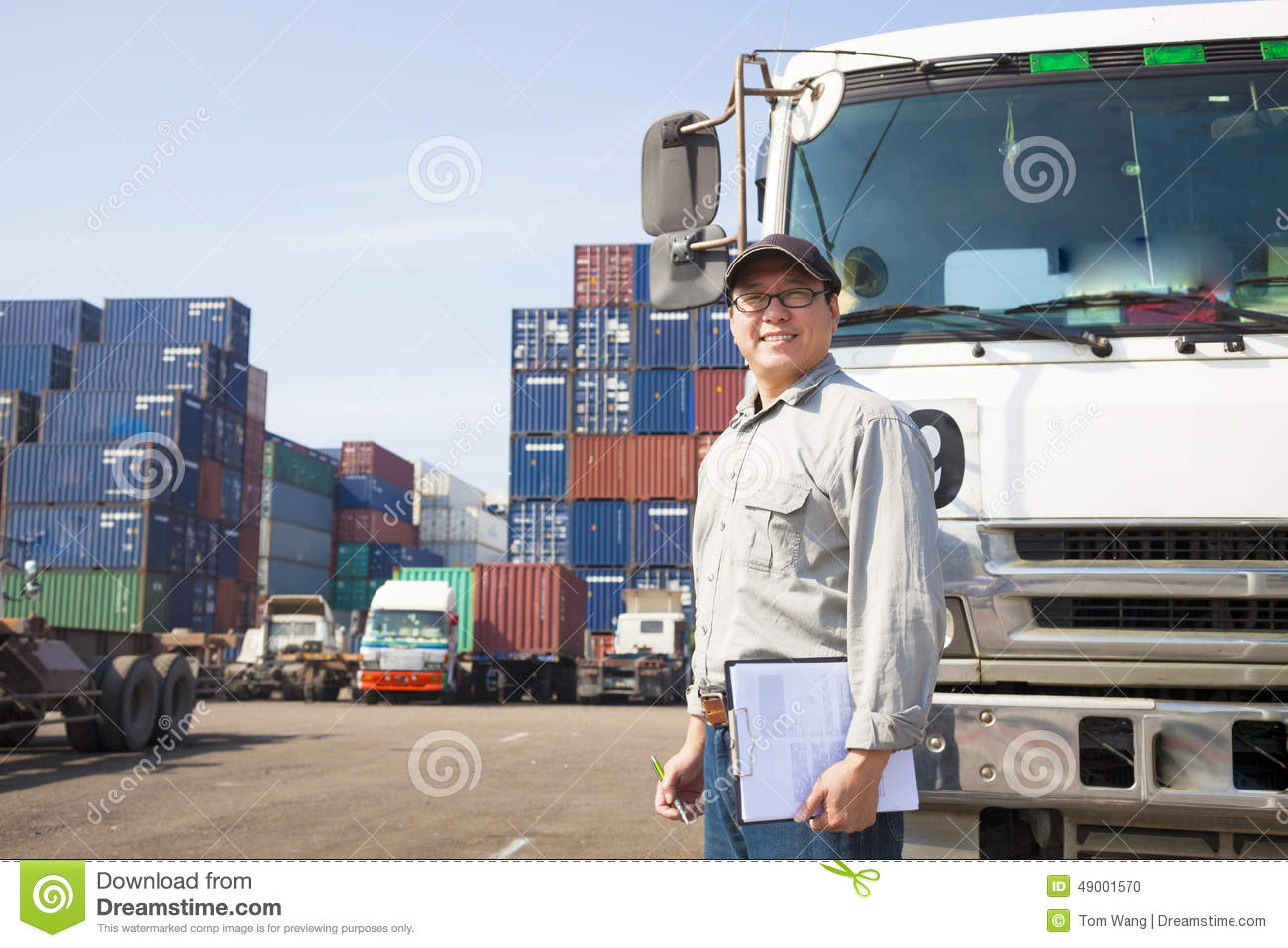 Download Driver In Front Of Container Truck Stock Photo - Image of worker, post: 49001570