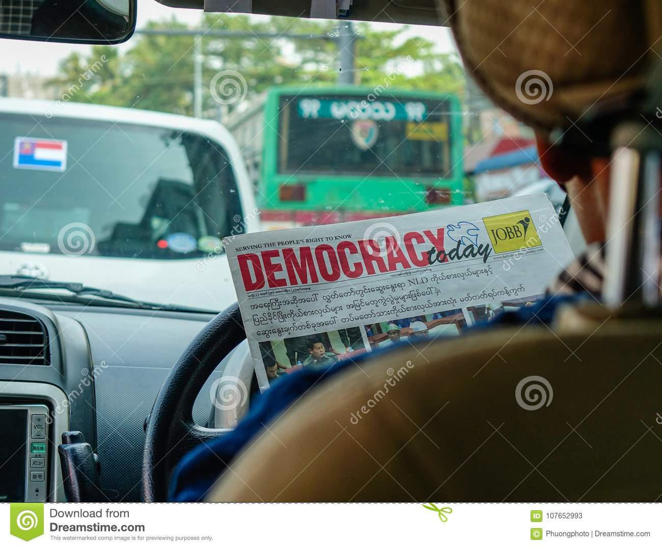 driver reading news in car editorial stock photo. image of info