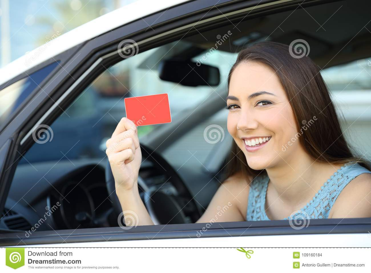 Driver showing a blank card inside a car