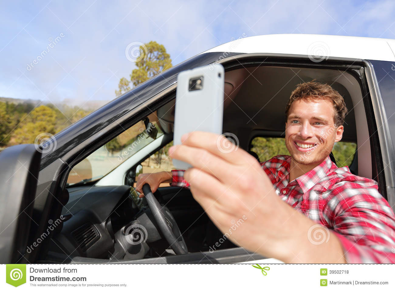 Driver taking photo with camera smartphone driving