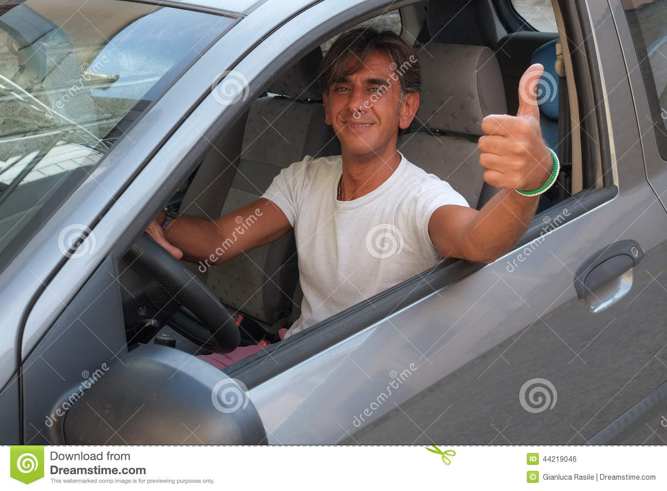 Driver with thumb up