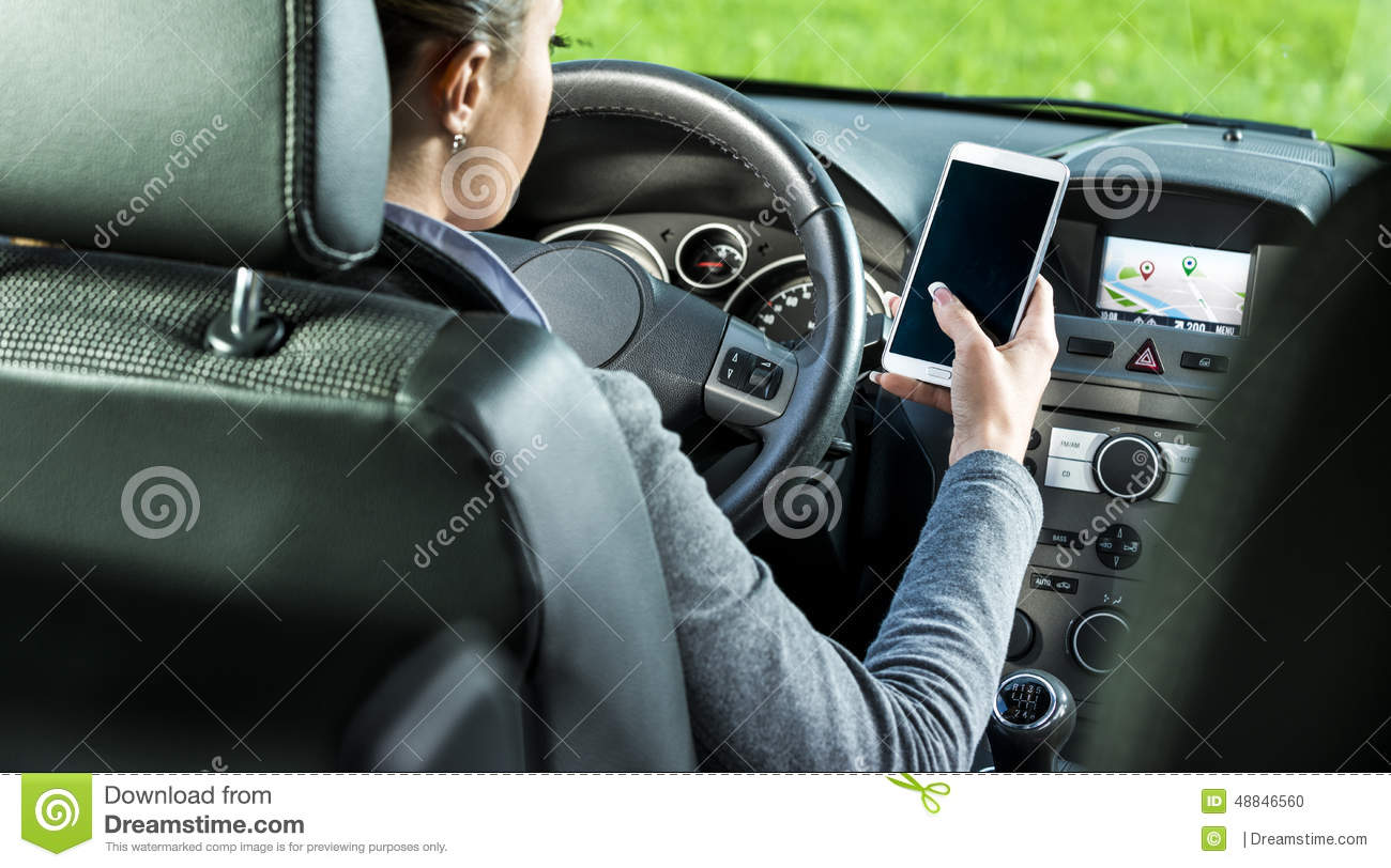 Driver using smartphone and gps navigation in a car