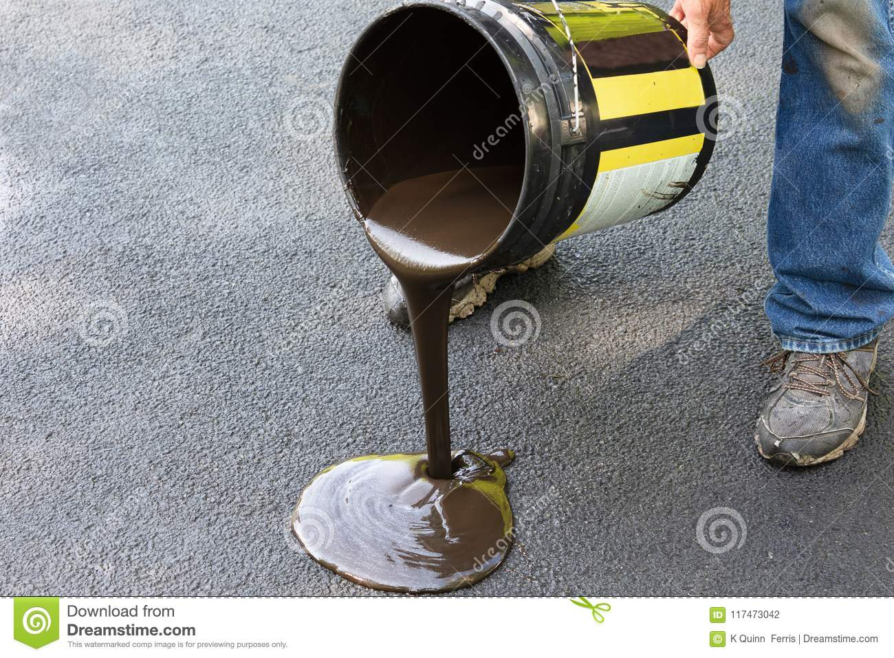 Driveway maintenance pouring sealant onto asphalt stock photo download comp solutioingenieria Choice Image