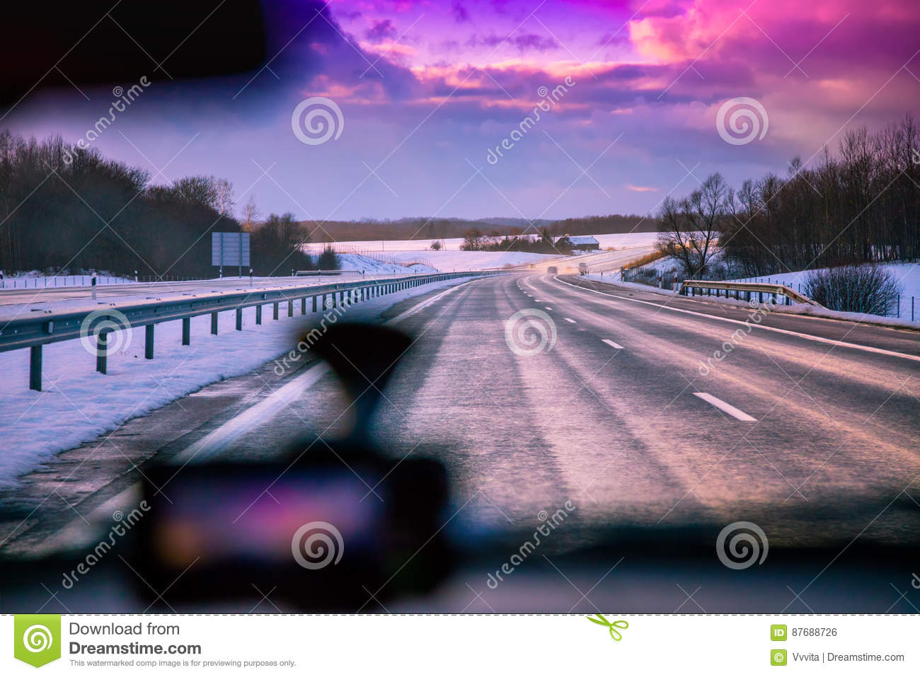 Driving on the Autobahn in the winter at sunset