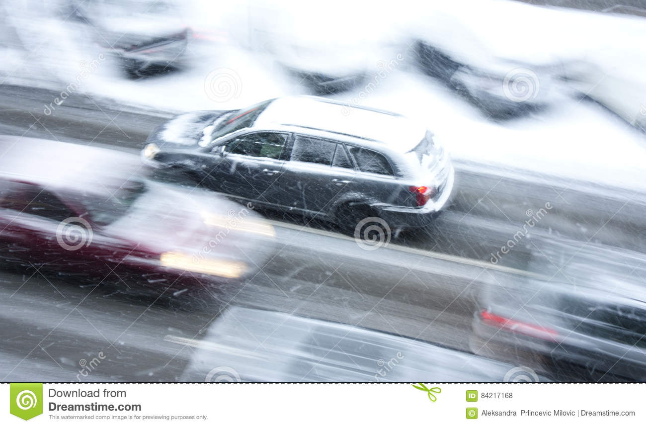 Driving Cars On The Snowy City Street In Motion Blur Stock Photo