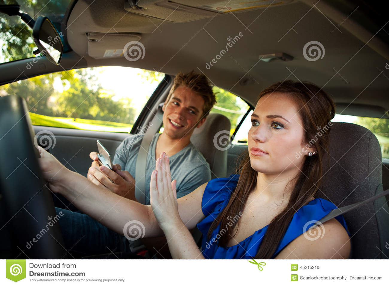 Driving Driver Ignores Friend With Phone Stock Photo Image