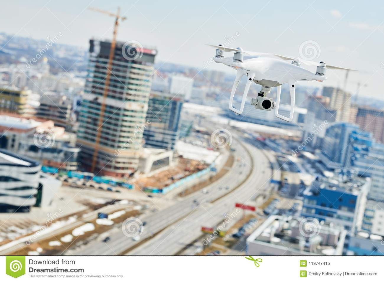 Drone with digital camera hovering over city