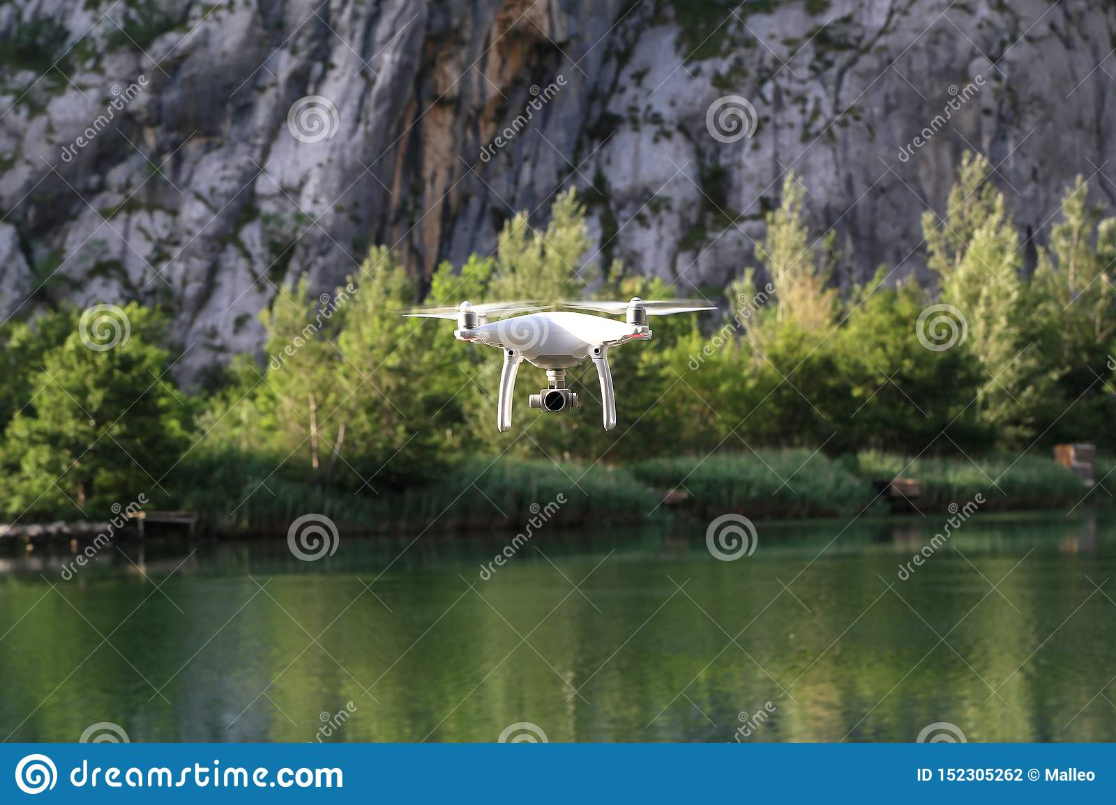 Drone flies low above water on lake