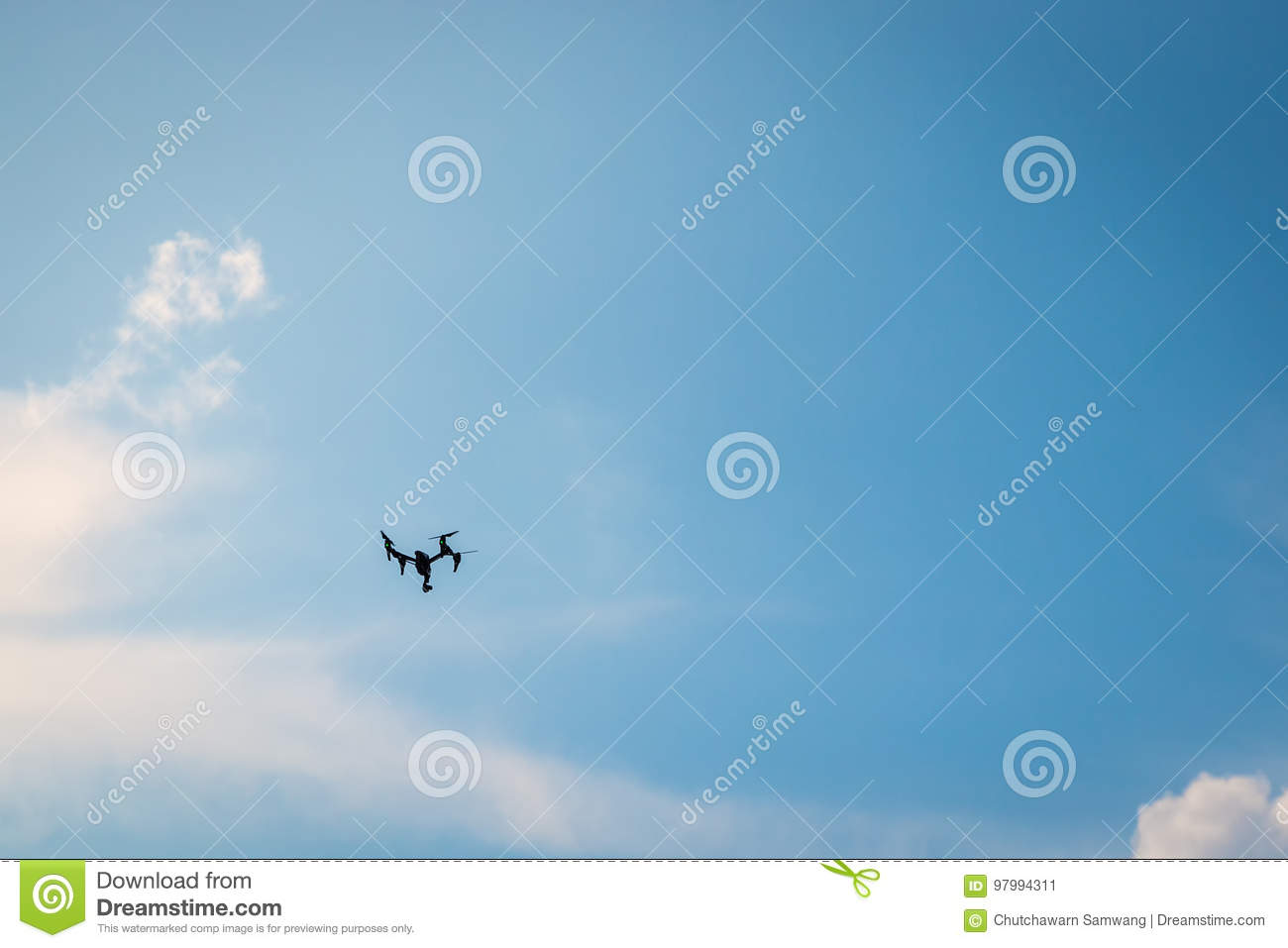 Drone hovering in a blue sky