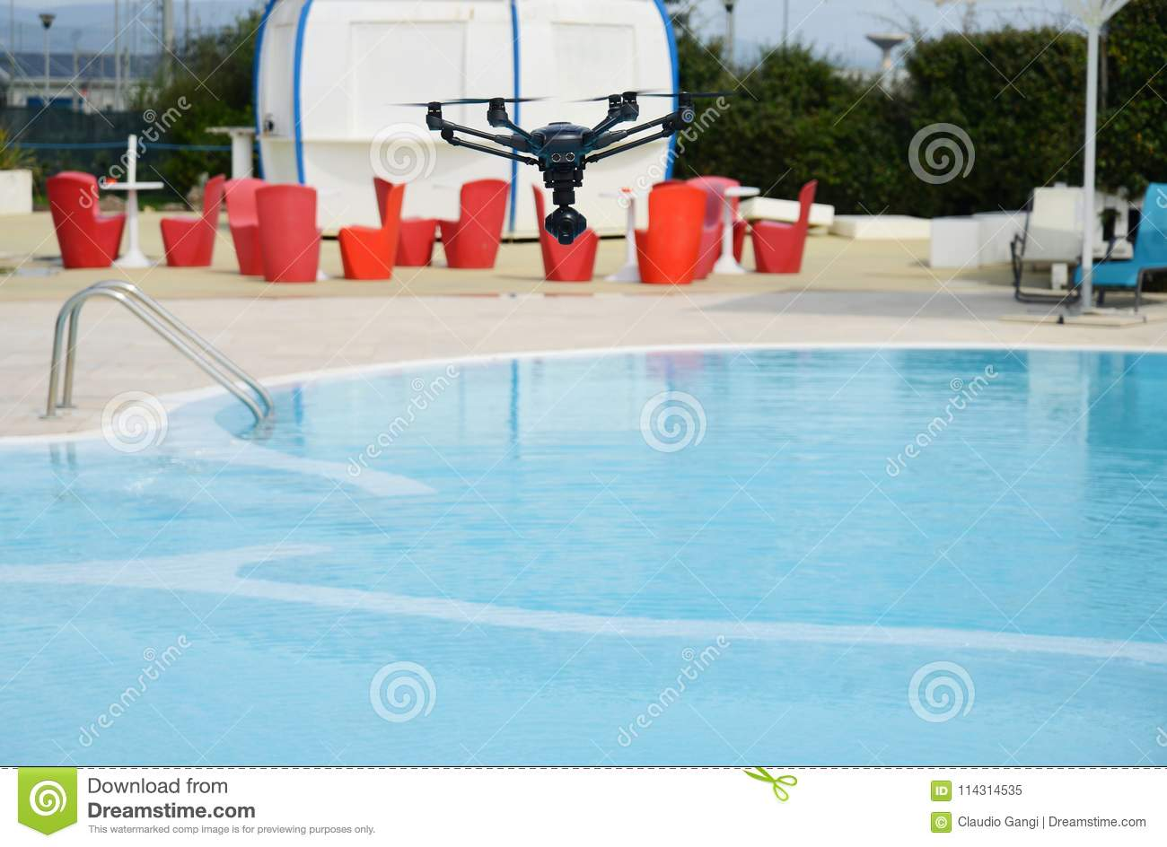 Drone hovering over swimming pool