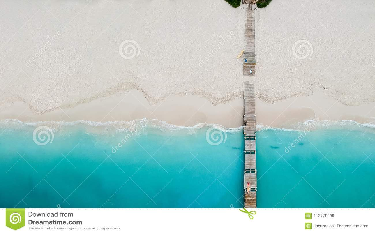 Drone panorama of pier in beach in Grace Bay, Providenciales, Tu