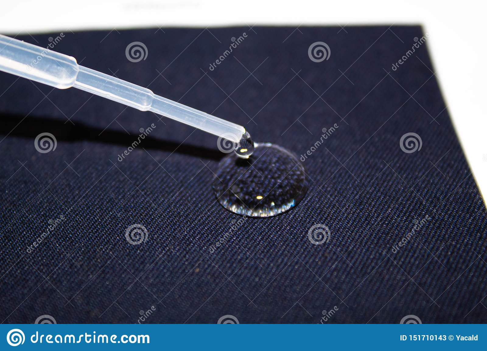 Drop of water on a piece of fabric