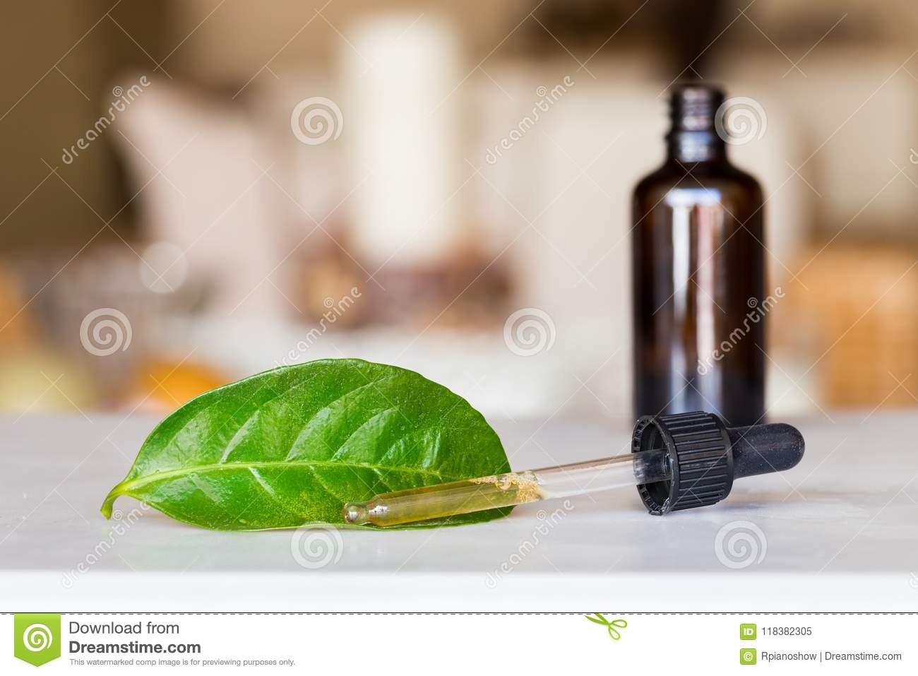 Dropper with liquid with a bottle and a green leaf