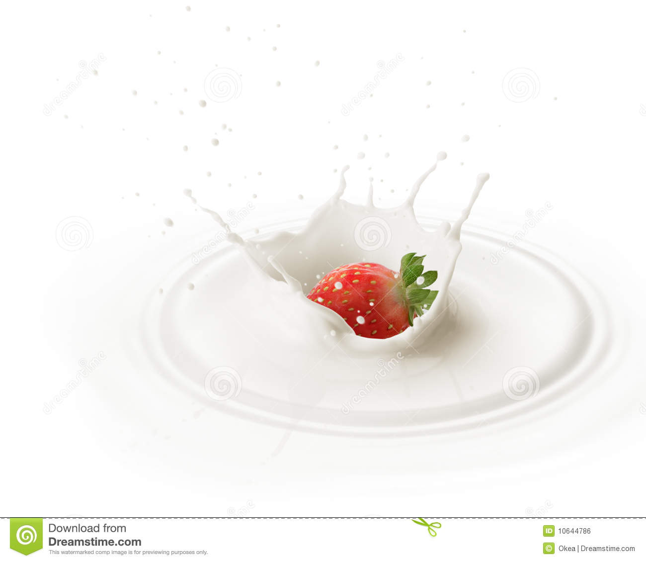 Dropping strawberry into milk