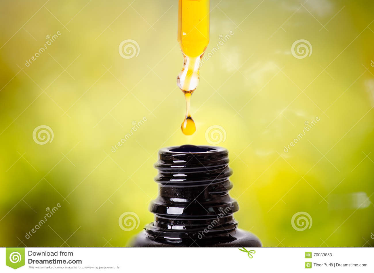 Drops from a dropper in a bottle. Isolated on a white background. Pharmacy and healthy background. Medicine. .
